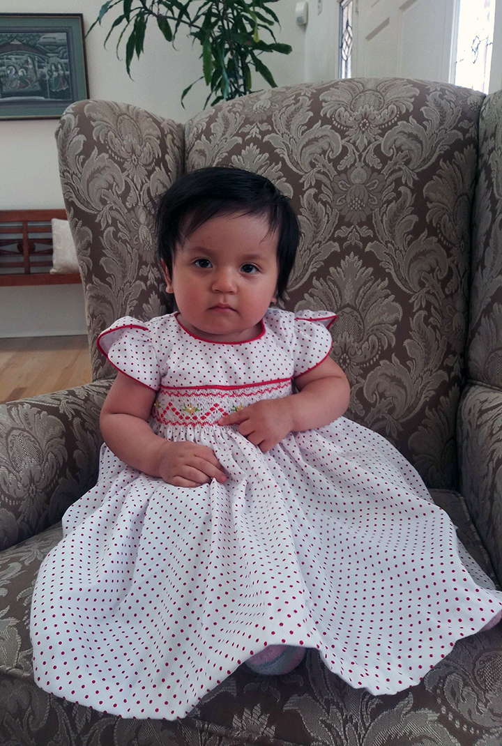 Chiara is one year old, with brown eyes and black hair. She was last seen wearing a blue flower dress.