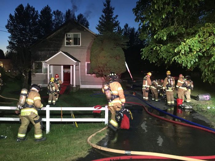 Fire District 7 first responders battle house fire in Monroe. Photo courtesy of Fire District 7.