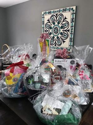 Just SOME of the raffle prizes that will be up for grabs at the Spaghetti Dinner.  Photo courtesy of Woodside PTA Facebook Page.