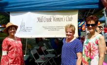 From left to right: Linda Wood, Sue Sherey, and Pam Brandon at the Mill Creek Festival. Photo courtesy of Mill Creek Women's Club.