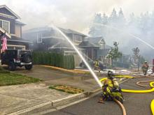Firefighters attack house fire east of Silver Lake. Photo courtesy of Fire District 1.