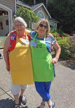 Garden Club friends, Michael Crawford and Diane Stone, having fun being greeters on Garden Tour Day! There's never a dull moment when these two get together! Photo courtesy of Mill Creek Garden Club.