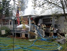 No one was injured in a fire just before 7 a.m. on April 13, 2013 that caused heavy damage and forced a couple from their mobile home in the Silver Lake neighborhood south of Everett.