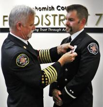 Fire Chief Gary Meek pinning badge on Lieutenant Michael McConnell. Photo courtesy of Fire District 7.