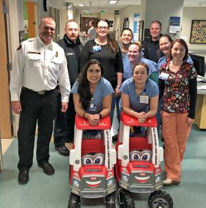 On Thursday, January 17, 2019, Snohomish County Fire District 7 firefighters made a special delivery to floor eight at the Burn Center at Harborview Medical Center. They had pooled together enough money to purchase not one, but two toy fire engines for the kids there.