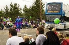 Clean air superhero Oxy Gene will lead a Double Tall bus in the Strawberry Festival Parade Saturday, June 16th, in Marysville. Photo courtesy of Community Transit.
