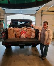 "The Mill Creek Garden Club Board threw down the challenge to our members with a ""Thanks for Giving"" food drive to benefit families served by the Mill Creek Community Food Bank. The club donated 1,095 pounds of goods, besting last year's total of 600 pounds."